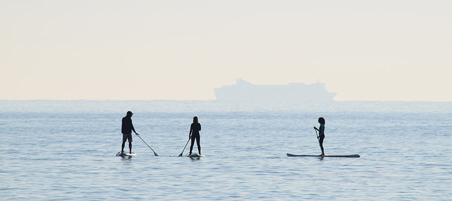 sports to practice as a couple, Paddle Surfing